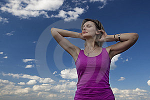 Young Female Against Blue Sky Royalty Free Stock Image - Image: 15171786