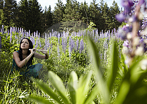 Attractive Girl With Flute Sitting In Summer Field Stock Images - Image: 15172214