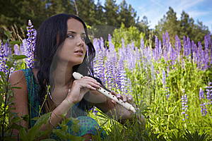 Attractive Girl With Flute Sitting In Summer Field Royalty Free Stock Photo - Image: 15172235