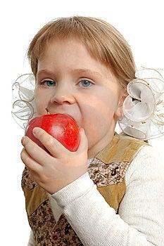 The Little Girl Biting An Apple Stock Photos - Image: 15173083