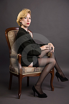 Woman In A Business Suit Sits In An Armchair Stock Images - Image: 15176164
