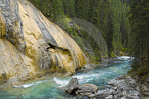 Flowing River Next To Red Rock Royalty Free Stock Photography - Image: 15178007
