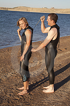 Helping Wet Suit Stock Image - Image: 15178401