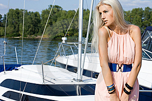 Woman Near The Boat Stock Photos - Image: 15190023