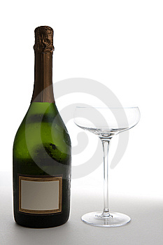 Champagne Bottle Next To An Empty Glass Royalty Free Stock Photos - Image: 15196388