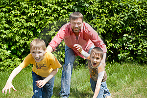 Father Playing With Two Children Stock Photo - Image: 15202620