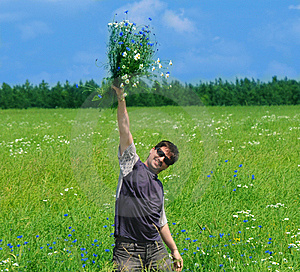 Young Adult Man With Bouquet Of Wildflowers Stock Photography - Image: 15204522