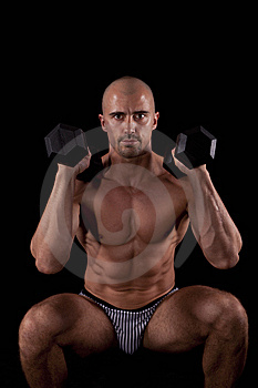 Muscle Young Man With Dumbells Royalty Free Stock Image - Image: 15209626