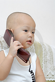 Baby With Telephone Royalty Free Stock Image - Image: 15218696