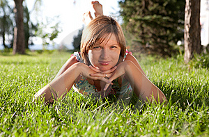 The Girl Having A Rest On A Grass Stock Image - Image: 15220591