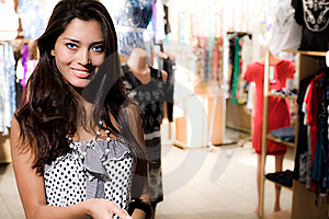 Smiling Girl Is Shopping Royalty Free Stock Photos - Image: 15221418