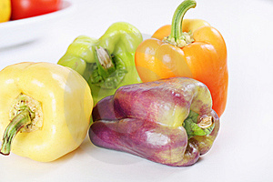Purple, Yellow, Orange & Green Baby Bell Peppers Stock Images - Image: 15225894