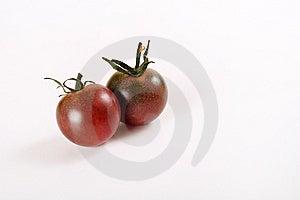 Tiny Heirloom Deep Purple Cherry Tomatoes Royalty Free Stock Photography - Image: 15225907