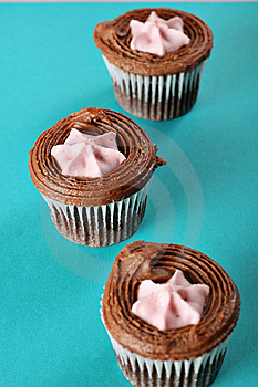 3 Cupcakes On Blue Green Background Royalty Free Stock Image - Image: 15225946