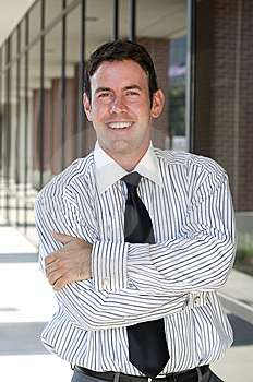 Handsome Businessman With Arms Crossed Stock Images - Image: 15239054