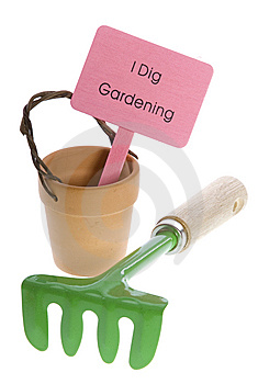 Pink Sign In Empty Pot With Rake Stock Photo - Image: 15268740