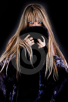 Girl Hiding Behind Coat Royalty Free Stock Photo - Image: 15274085