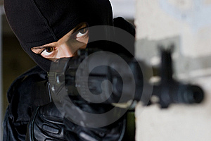 Terrorist targeting with a gun Stock Image