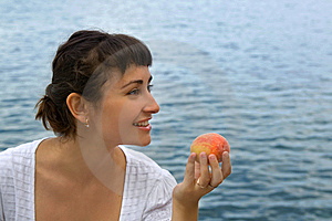 Young Girl With The Peach Stock Images - Image: 15276704