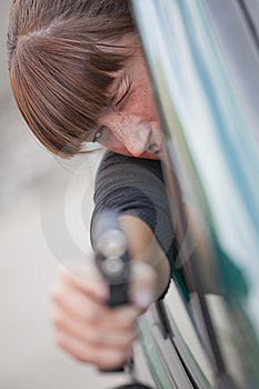 Woman Shooting From A Car Stock Photography - Image: 15278172
