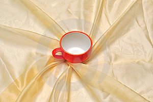 Red Cup At The Golden Fabric Drapery Royalty Free Stock Photos - Image: 15281118