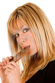 Young Girl Eating Chocolate Stock Photos - Image: 1535303
