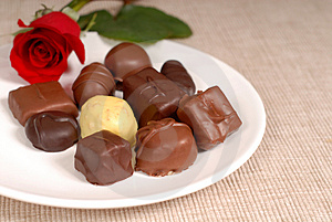 Variety Of Chocolates And A Rose On A White Plate Royalty Free Stock Image - Image: 1535416