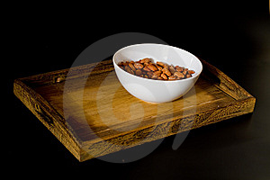 Bowl With Almonds On Wooden Tray Royalty Free Stock Photo - Image: 15313005