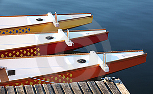 Three Colorful Paddle Boats At A Dock Stock Photos - Image: 15313623