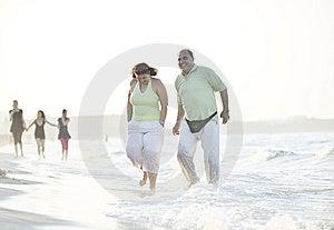 Happy Seniors Couple  On Beach Stock Photo - Image: 15348460
