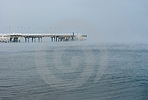 Frozen Pier, Lonely Man Royalty Free Stock Photography - Image: 15365647