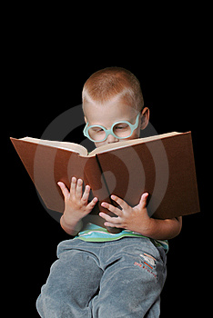 Smart Boy With Glasses Reading Book Stock Photography - Image: 15382502