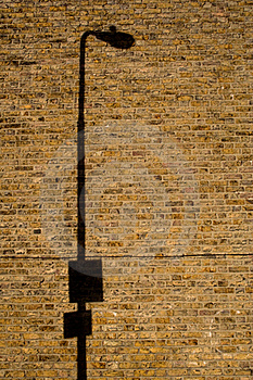 Lamp Post Shadow On Brick Wall Stock Photography - Image: 15389432