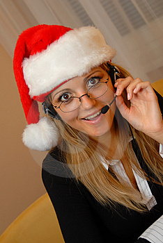 Phone Operator With A Christmas Cap Royalty Free Stock Images - Image: 1544809
