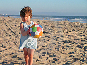 Girl Playing At The Beach Royalty Free Stock Photos - Image: 1549548