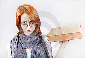 Young Girl In Glasses With Age Book. Stock Photography - Image: 15402252