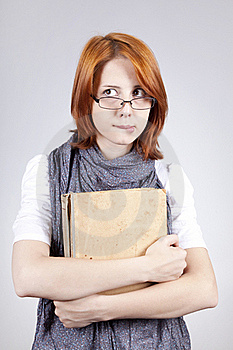 Doubting Fashion Girl In Glasses With Old Book Royalty Free Stock Image - Image: 15402276