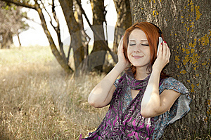 Young Smiling Girl With Headphones Near Tree. Stock Photos - Image: 15402513