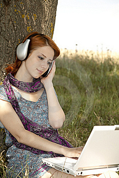 Young Smiling Girl With Notebook And Headphones Royalty Free Stock Images - Image: 15402539