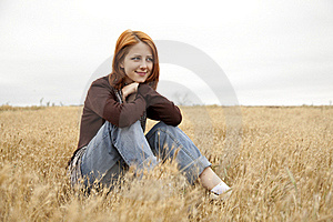 Beautiful Red-haired Girl At Yellow Autumn Grass. Stock Photo - Image: 15402750