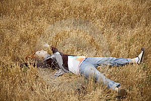 Young Beautiful Girl Lying At Yellow Autumn Field. Stock Photography - Image: 15402852