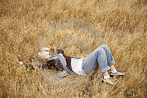 Young Beautiful Girl Lying At Yellow Autumn Field. Stock Images - Image: 15402854
