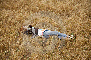Young Beautiful Girl Lying At Yellow Autumn Field. Stock Photos - Image: 15402913