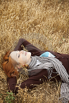 Young Beautiful Girl Lying At Yellow Autumn Field. Royalty Free Stock Image - Image: 15402946