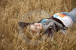 Young Beautiful Girl Lying At Yellow Autumn Field. Stock Photos - Image: 15402993