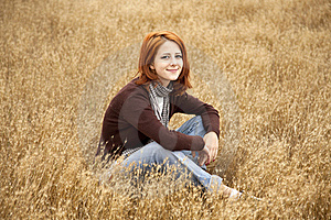 Beautiful Red-haired Girl At Yellow Autumn Grass. Stock Photos - Image: 15403013