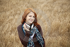 Young Girl With Headphones At Field. Stock Photography - Image: 15403082