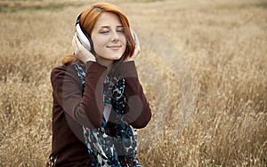 Young Girl With Headphones At Field. Stock Images - Image: 15403164