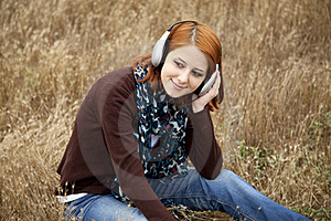 Young Girl With Headphones At Field. Royalty Free Stock Images - Image: 15403189