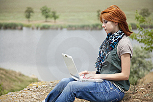 Young Girl With Laptop At Rock Near Lake Royalty Free Stock Photography - Image: 15403377